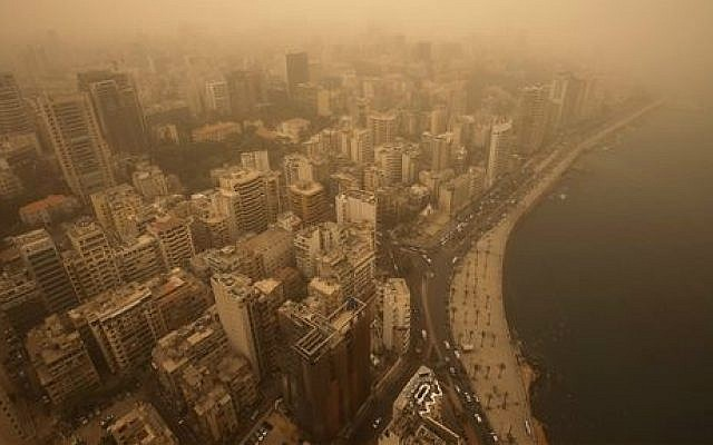 A sandstorm shrouds the city of Beirut, Lebanon, Tuesday, Sept. 8, 2015. (AP Photo/Hussein Malla)