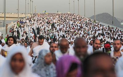 "Hundreds of thousands of Muslim pilgrims make their way to cast stones at a pillar symbolizing the stoning of Satan, in a ritual called ""Jamarat,"" the last rite of the annual hajj, on the first day of Eid al-Adha, in Mina near the holy city of Mecca, Saudi Arabia, Sept. 24, 2015. (AP/Mosa'ab Elshamy)"