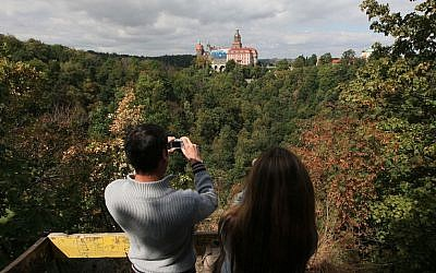 A German tourist takes picture of Ksiaz Castle, under which the Nazi gold train is said to be hidden,  in Walbrzych, Poland, on Wednesday, September 2, 2015. (Czarek Sokolowski/AP Photo)