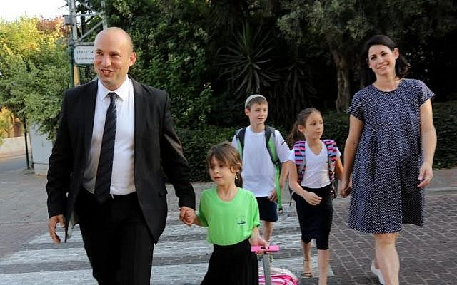 Education Minister Naftali Bennett walks his little girl Avigail to first grade, her first day of school and his first opening of a school year as the education minister, on Tuesday, September 1, 2015. (Sasson Tiram)