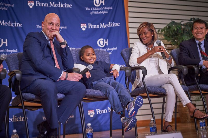 Dr. L. Scott Levin, Zion Harvey, and mother Pattie Ray at an August 26, 2015 press conference almost two months post-op. (courtesy The Children's Hospital of Philadelphia)