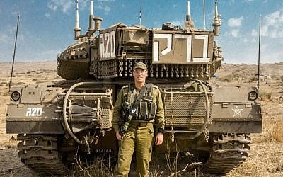 Commander of the 188th Armored Brigade Col. Nir Ben-David stands in front of his tank during an exercise in the Golan Heights on Oct. 19, 2015. (IDF Spokesperson's Unit)