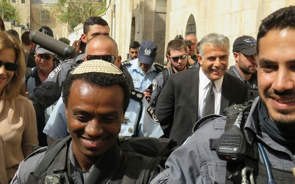 Yesh Atid leader Yair Lapid (in suit and tie) during a tour by members of his party to the Old City in Jerusalem. (Courtesy Yesh Atid)
