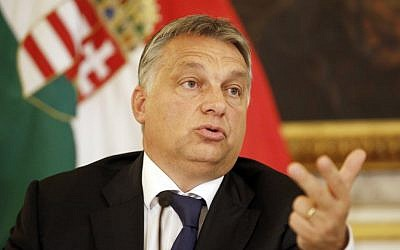 Hungarian Prime minister Viktor Orban speaks during a press conference at the Hungarian Embassy on September 25, 2015 in Vienna. (AFP PHOTO / DIETER NAGL)