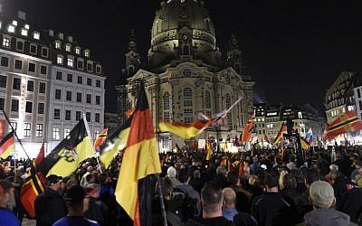 Supporters of the far-right PEGIDA movement attend a protest rally on October 5, 2015 in Dresden, eastern Germany (Tobias Schwarz/AFP)