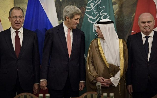(From left) Russian Foreign Minister Sergei Lavrov, US Secretary of State John Kerry, Saudi Foreign Minister Adel al-Jubeir and Turkish Foreign Minister Feridun Sinirlioglu stand together before a meeting at the Hotel Imperial on October 29, 2015 in Vienna, Austria. (AFP PHOTO / POOL / BRENDAN SMIALOWSKI)