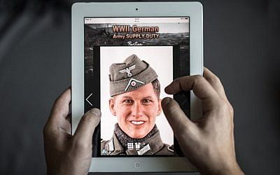 Illustrative photo of a man browsing the website of DiD, a company that produced a Nazi-uniform-clad figurine with a face similar to Bastian Schweinsteiger, in Hong Kong on October 23, 2015. (AFP/Philippe Lopez)