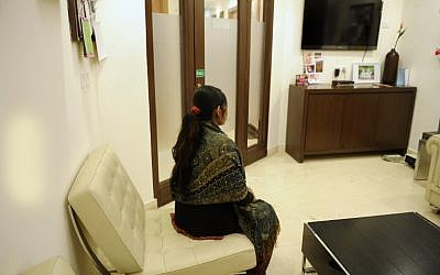 In this file photo taken on February 5, 2013, an Indian surrogate mother sits at the Surrogacy Centre India (SCI) clinic in New Delhi. (Photo by AFP Photo / Sajjad Hussain)