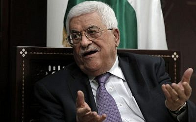 Mahmoud Abbas speaks with journalists at his office in the West Bank city of Ramallah on October 6, 2015. AFP/AHMAD GHARABLI)