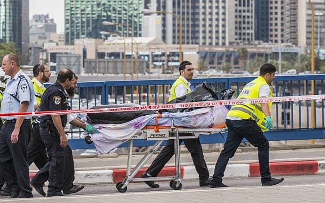 ZAKA volunteers remove the body of a Palestinian shot dead after carrying out a stabbing attack in Tel Aviv on October 8, 2015. (AFP/Jack Guez)