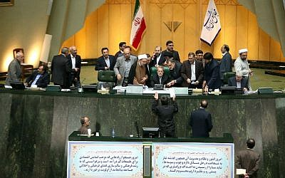 File: Iran's Parliament during a session in Tehran on October 13, 2015 in which the parliament approved its nuclear deal with world powers, paving the way for the historic agreement curbing Tehran's atomic program to take effect and for the eventual lifting of sanctions.  ( AFP / Tasnim / Meghdad Madadi)