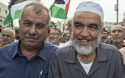 Islamic Movement leader Sheikh Raed Salah (right), and former Arab MK Mohammad Barakeh attend a demonstration in Sakhnin on October 13, 2015. (AFP/Jack Guez)