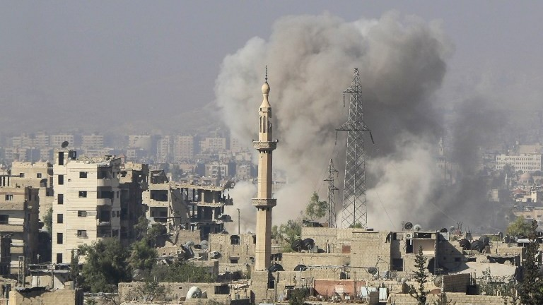A picture shows smoke billowing following a reported Syrian regime bombings on rebel positions in Jobar, in eastern Damascus, on October 15, 2015. (Ammar Suleiman/AFP)