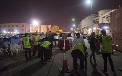 Saudi Shiite worshipers are frisked by members of security as they make their way to a hussainiya, a Shiite hall used for commemorations, in the mainly Shiite coastal town of Qatif, 400 kms east of Riyadh, on October 16, 2015. (AFP PHOTO/HUSSEIN RADWAN)