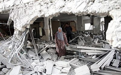 Illustrative photo of a Palestinian woman walking amid the rubble of a house after Israeli security forces demolished the homes of two Palestinians behind attacks in the Palestinian neighborhood of Jabal Mukaber in East Jerusalem, on October 6, 2015. (AFP/THOMAS COEX)
