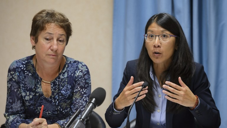 Doctors Without Borders, also known by its French name Medecins Sans Frontieres (MSF) International President Joanne Liu (R) gestures as she speaks, next to MSF Lead Counsel Francoise Saulnier, during a press conference in Geneva on October 7, 2015. (Fabrice Coffrini/AFP)