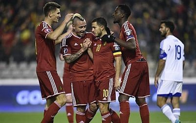 Belgium's midfielder Eden Hazard (c) is congratulated by teammates after scoring a goal during the Euro 2016 qualifying football match between Belgium and Israel, at the King Baudouin Stadium, on October 13, 2015 in Brussels. (AFP/ JOHN THYS)