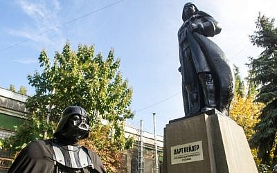 A participant dressed as Darth Vader, a character from the 'Star Wars' film, takes part in an inauguration ceremony of a Darth Vader monument, formerly a statue of Soviet founder Lenin, in the southern Ukrainian city of Odessa on October 23, 2015. (AFP/ VOLODYMYR SHUVAYEV)
