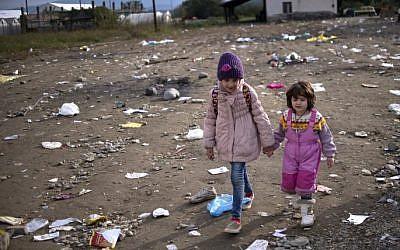 Migrant children arrive at the registration camp after crossing the Greek-Macedonian border near Gevgelija on October 29, 2015. (Nikolay Doychinov/AFP)