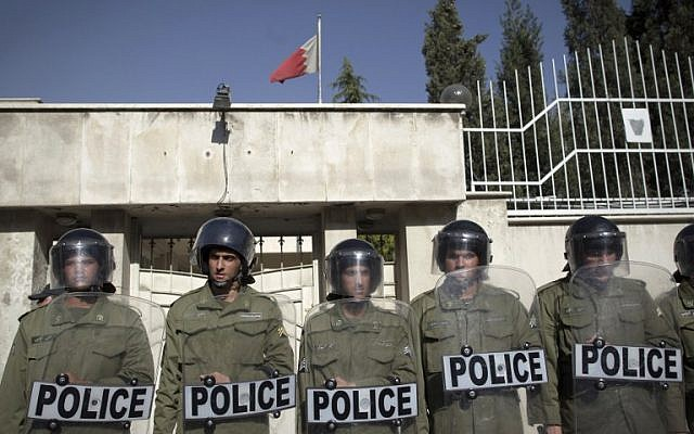 Iranian riot policemen standing guard outside the Bahraini Embassy in Tehran as Iranian hardliners hold a demonstration against the Bahraini government's suppression of protests led by the mainly-Shiite opposition in the kingdom, April 15, 2011. (AFP/Behrouz Mehri, File)