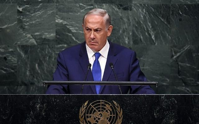 Prime Minister Benjamin Netanyahu stares silently at the crowd while addressing the 70th Session of the United Nations General Assembly at the UN in New York on October 1, 2015 (AFP Photo/Jewel Samad)