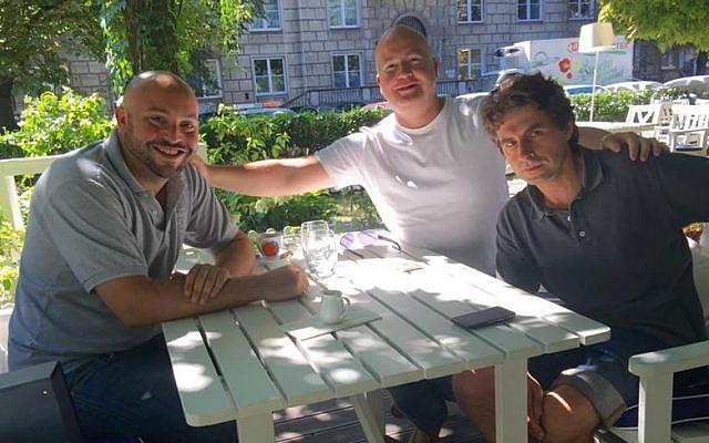Benjamin Krasicki, center, and Jonny Daniels, left in Warsaw in August 2015. (Courtesy of From the Depths/JTA)