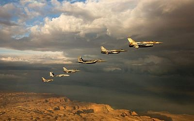 Israeli and foreign fighter jets fly in formation through cloudy skies over the Negev desert during the 'Blue Flag' exercise at Ovda Airfield near Eilat on October 27, 2015. (Israeli Air Force)