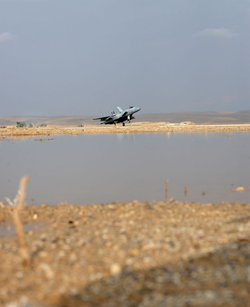 An Israeli Air Force F-15 fighter jet makes a landing onto a slightly flooded runway during the 'Blue Flag' exercise in southern Israel on Oct. 26, 2015. (Israel Air Force)