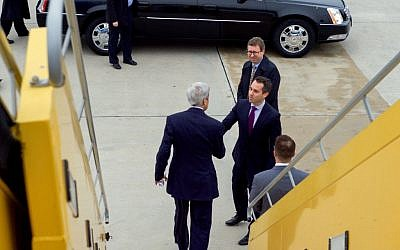 John Kerry shakes hands with US Ambassador to the Organization for Security and Cooperation in Europe Daniel Baer after arriving in Vienna, Austria, on October 29, 2015. (US State Department)