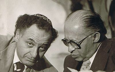 Former prime minister Menachem Begin (right) confers with advisor Yehuda Avner. (Courtesy of Moriah Films)
