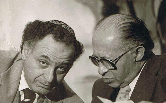 Prime Minister Menachem Begin (right) confers with advisor Yehuda Avner. (Courtesy of Moriah Films)