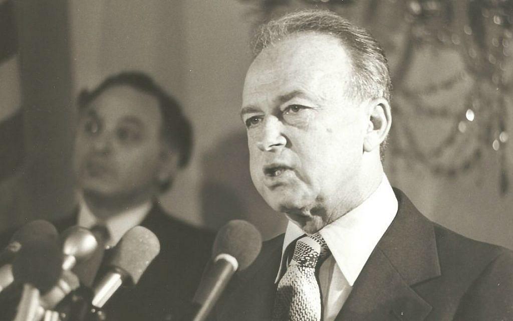 Prime minister Yitzhak Rabin speaks, with Yehuda Avner in the background. (Courtesy of Moriah Films)