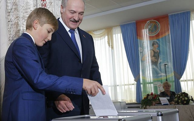 Belarusian President Alexander Lukashenko with his youngest son Nikolai casts his ballot at a polling station, during the presidential election, in Minsk, Belarus, Sunday, Oct. 11, 2015. (Photo by AP Photo/Sergei Grits)
