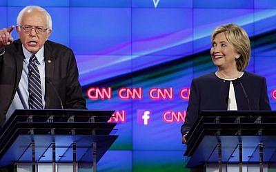 Hillary Rodham Clinton and Sen. Bernie Sanders, of Vermont, speak during the CNN Democratic presidential debate Tuesday, Oct. 13, 2015. (AP Photo/John Locher)