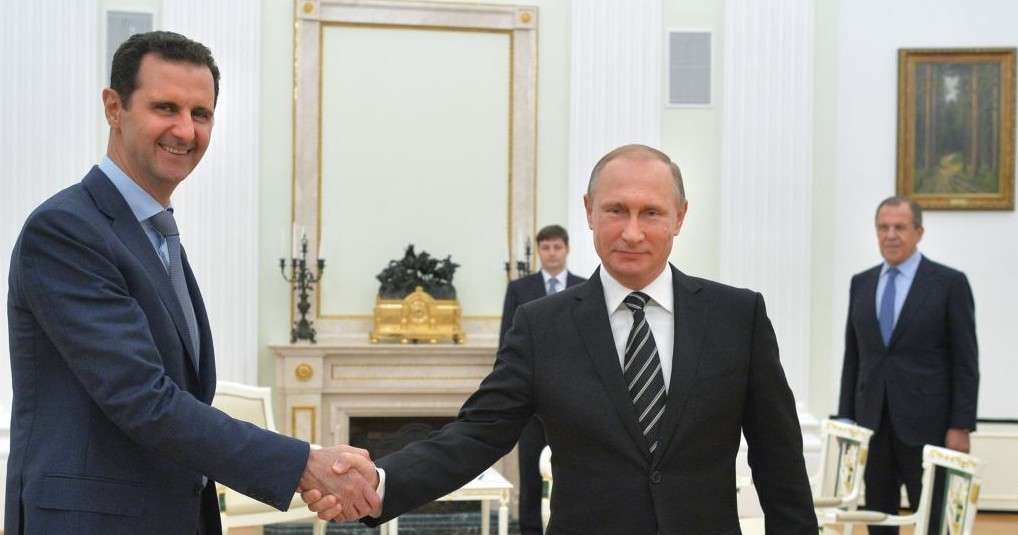 Russian President Vladimir Putin (center), shakes hands with Syrian President Bashar Assad as Russian Foreign Minister Sergey Lavrov (right), looks on in the Kremlin in Moscow, Russia, October 20, 2015. (Alexei Druzhinin, RIA-Novosti/Kremlin Pool Photo via AP)