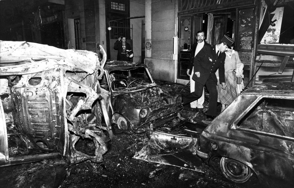 This Oct. 3, 1980 file photo shows the scene after the bombing of the Copernic street synagogue, in Paris, that killed 4 people. (AP Photo/Remy de la Mauviniere)