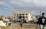 Egyptians gather at the scene following a bombing that struck a main police station in the capital of the northern Sinai province in el-Arish, Egypt, April 12, 2015. (Muhamed Sabry/AP)