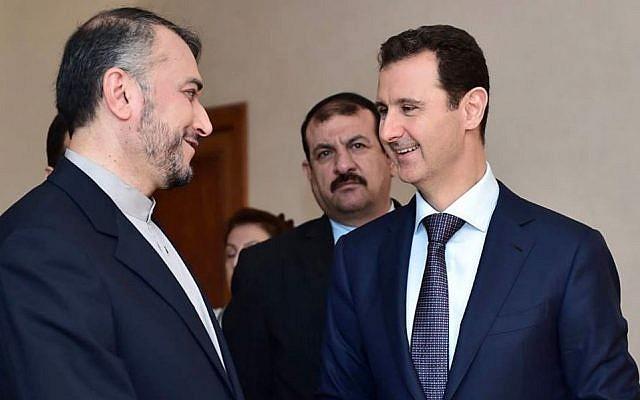 Syrian President Bashar Assad, right, speaks with Iran's Deputy Foreign Minister Hossein Amir Abdollahian, left, in Damascus, Syria, Thursday, Sept. 3, 2015 (Syrian presidency Facebook page)