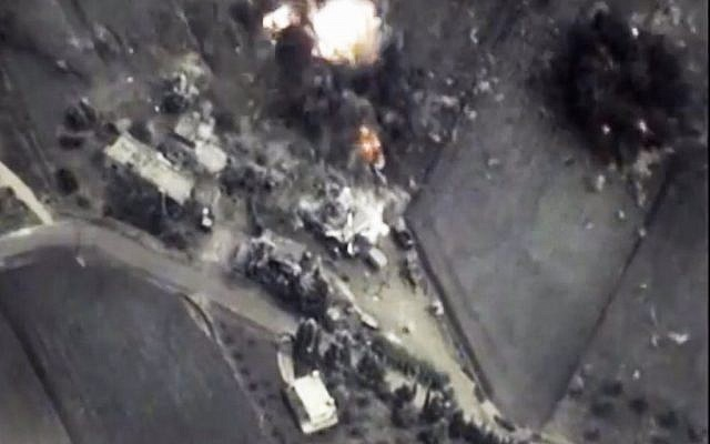 Footage from the Russian Defense Ministry official web site on Thursday, October 1, 2015 a bomb explosion is seen in Syria.  (Russian Defense Ministry Press Service/AP)