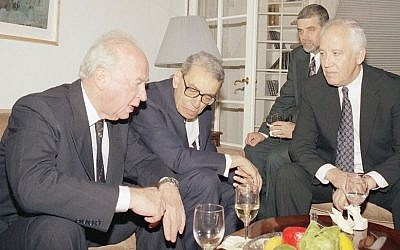 Israeli prime minister Yitzhak Rabin, left, with United Nations secretary general Boutros Boutros-Ghali and Gad Yaacobi, right, Israel's UN ambassador on Friday, November12, 1993, at Yaacobi's residence in New York. Shimon Sheves, behind Yaacobi, the director of the Prime Minister's office, listens in. (AP Photo/David Karp)