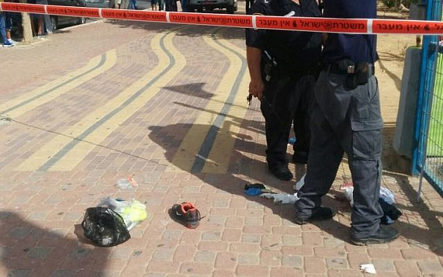 Israeli police at the scene where a Jewish man stabbed an Arab man in the southern city of Dimona on Friday, October 9, 2015. Three other Arab men were also injured in the attack. (Dimona Police Department)