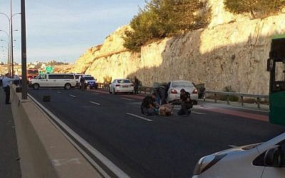 Medics at the scene of an attempted suicide bombing near Jerusalem on Sunday morning, October 11, 2015 (Courtesy of Israel Police)