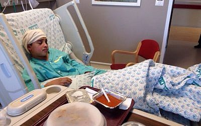 Ahmad Manasra, one of two cousins who went on a stabbing frenzy in Jerusalem on October 12, 2015 is seen at the Hadassah Ein Kerem Hospital in Jerusalem on October 15, 2015. Manasra was hit by a car while fleeing from the scene of the attack. (Courtesy)