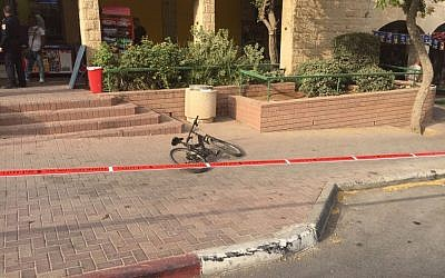 The bicycle a 13-year-old boy was riding before he was stabbed in the Pisgat Zeev neighborhood of Jerusalem on October 12, 2015. (Israel Police Spokesperson's Unit)