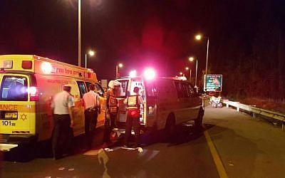 Magen David Adom paramedics at the scene of a multiple stabbing attack near Hadera, on October 11, 2015. (Assaf Brezinger/Magen David Adom)