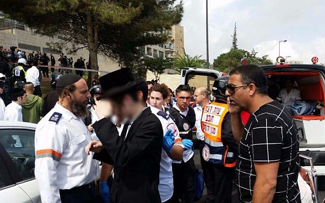 Emergency medical personnel at the scene of a stabbing attack in Jerusalem on October 9, 2015 (Magen David Adom)