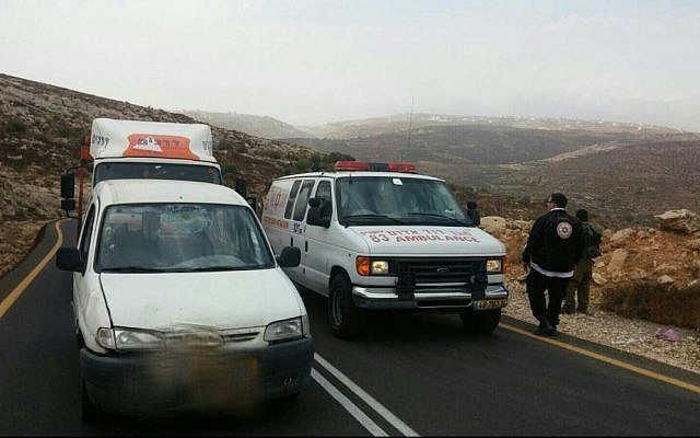 An ambulance is seen on a road in the West Bank where a man was stabbed by a Palestinian terrorist on Sunday, October 25, 2015. (Magen David Adom)
