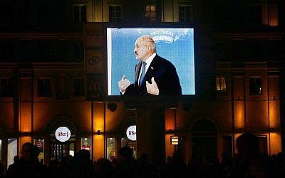 Belarusian President Alexander Lukashenko is seen on a large screen, speaking to media at a polling station after voting during presidential elections in Minsk, Belarus, late Sunday, October 11, 2015. (Photo by AP Photo/Sergei Grits)