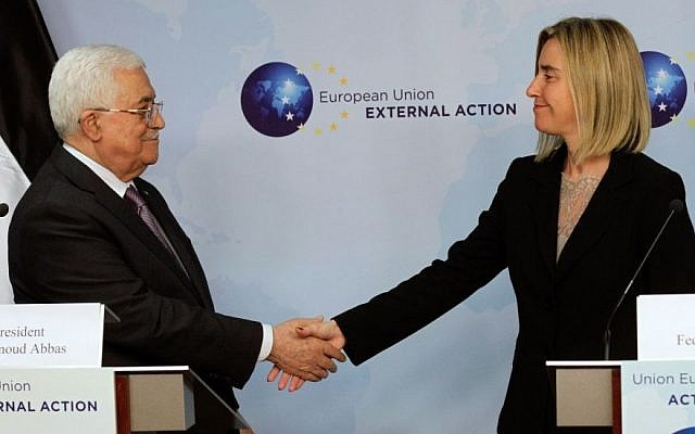 European Union High Representative Federica Mogherini, right, shakes hands with Palestinian Authority President Mahmoud Abbas prior to a meeting at the EU External Action Service building in Brussels on Monday, Oct. 26, 2015. (AP/Francois Walschaerts)