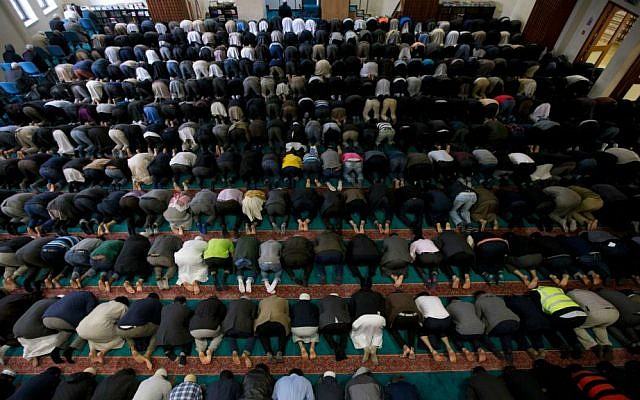 Illustrative: In this Sept. 15, 2015 photo, men take part in prayers at the 7,000-worshiper capacity East London Mosque, the largest mosque in the United Kingdom. (AP Photo/Matt Dunham)